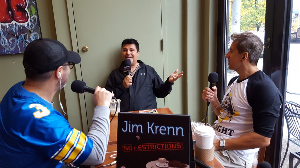 Frank Murgia and David Sedelmeier join Jim Krenn at his corner table at Delanie's Coffee.